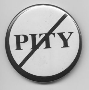 pity with a line through it on a white round button